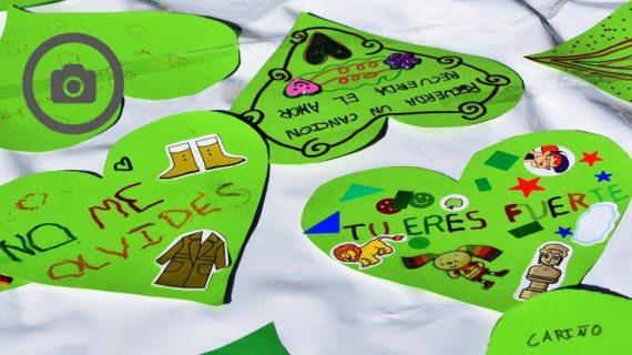 La Plaza Mayor 'late' con un inmenso corazón verde para visibilizar el Alzheimer